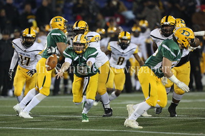 George P. Smith/The Montgomery Sentinel    Damascus High School's John Allan Fergeson (#9) pitching to his running back against Gwynn Park High School in the State 2A Final game played at Navy-Marine Corps Memorial Stadium in Annapolis on Saturday, December 2, 2017.
