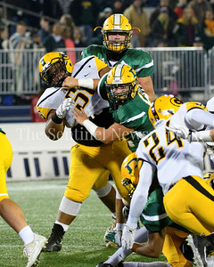 Damascus defensive tackle Michael Jurgens holds off Gwynn Park's guard, Myles Harris aiding in the thwarting of a Gwynn Park first down on third and long.  Damascus vs. Gwynn Park 2A State Championships Photo Credit:  David Wolfe