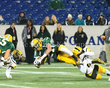 Running back Gage Dickens gets upended on his first run for a first down.  Damascus vs. Gwynn Park 2A State Championships Photo Credit:  David Wolfe