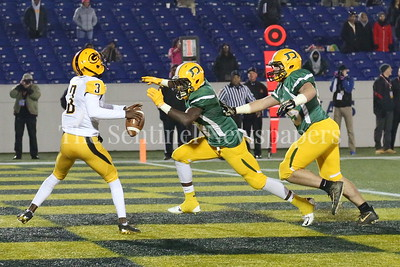 George P. Smith/The Montgomery Sentinel    Damascus High School's T.D. Ayo-Durojaiye (#34) and J.C. Philbin (#65) almost sacked Gwynn Park High School's Kamari Brown (#3) in their endzone for a safety but Brown got off an incompletion in the State 2A Final game played at Navy-Marine Corps Memorial Stadium in Annapolis on Saturday, December 2, 2017.