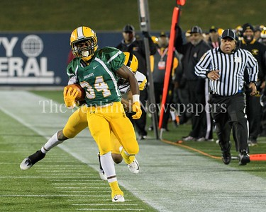 TD Ayo-Durojaiye holds the sideline as he gets nailed from behind.  Damascus vs. Gwynn Park 2A State Championships Photo Credit:  David Wolfe