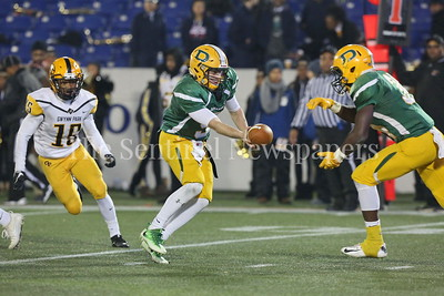 George P. Smith/The Montgomery Sentinel    Damascus High School's John Allan Furgeson (#9) handing off to T.D. Ayo-Durojaiye (#34) against Gwynn Park High School in the State 2A Final game played at Navy-Marine Corps Memorial Stadium in Annapolis on Saturday, December 2, 2017.