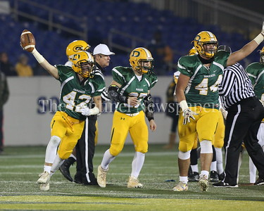 George P. Smith/The Montgomery Sentinel    Look What I've Got - Damascus High School's Timothy Fergeson (#42) celebrates after coming up with a fumble recovery against Gwynn Park High School in the State 2A Final game played at Navy-Marine Corps Memorial Stadium in Annapolis on Saturday, December 2, 2017.
