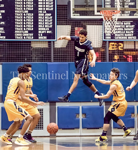 Springbrook's Matthew Balanc hovers over the B-CC defense