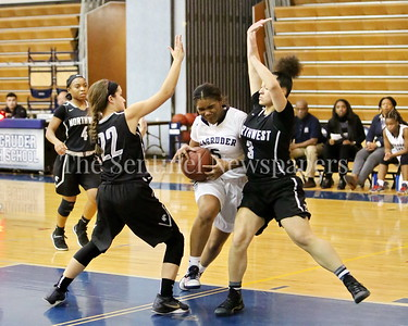George P. Smith/The Montgomery Sentinel    Magruder High School's L. Grant (#5) powers her way between Northwest High School defenders Laurel Cotton (#3) and Ashley Mustrom (#22) on the way to the hoop.