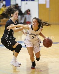 George P. Smith/The Montgomery Sentinel    Magruder High School's L. Mathis(#3) gets past Northwest High School's Christina Photinakis (#13).