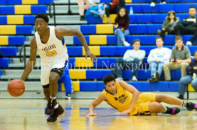Jao Ituka makes a break down the floor after stealing the ball from B-CC's Miles English resulting in a dunk for 2 by Ituka. Gaithersburg vs B-CC High School Boy Varsity Basketball Photo Credit:  David Wolfe