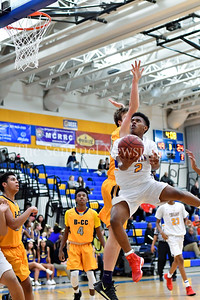 Jordan Graham of Gaithersburg flys in for an underhand layup for two. Gaithersburg vs B-CC High School Boy Varsity Basketball Photo Credit:  David Wolfe