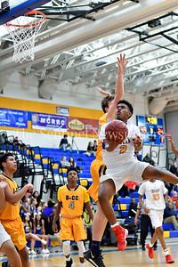 Jordan Graham of Gaithersburg flys in for an underhand layup for two. Gaithersburg vs B-CC High School Boy Varsity Basketball Photo Credit:  David Wolfe