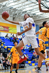 Gaithersburg's Jordan Hawkins breaks past 2 B-CC players in the lane to add 2 to the score. Gaithersburg vs B-CC High School Boy Varsity Basketball Photo Credit:  David Wolfe
