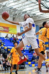 Gaithersburg's Jordan Hawkins breaks past 2 B-CC players in the lane to add 2 to the score. Gaithersburg vs B-CC High School Boy Varsity Basketball Photo Credit:  David Wolfe