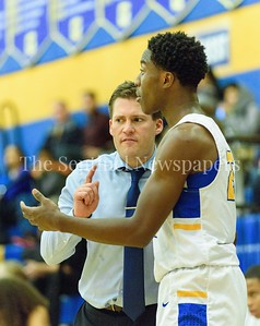 Coach Holden of Gaithersburg  shares with Jao Ituka while the team on the floor is waiting on foul shots. Gaithersburg vs B-CC High School Boy Varsity Basketball Photo Credit:  David Wolfe