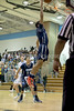 Springbrook's Matthew Balanc skys for a 2nd half rebound. PHOTO BY MIKE CLARK
