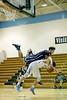 Springbrook's Markell McDaniels and Whitman's Joey Squeri chase a lose ball during the 2nd half. PHOTO BY MIKE CLARK