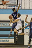 Whitman's Alex Sanson hangs in the air during a drive to the basket. PHOTO BY MIKE CLARK