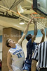 Whitman's Joey Squeri and Springbrook's Michael Germain get tangled in the net during a contested rebound. PHOTO BY MIKE CLARK