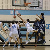 Alex Sanson of Springbrook makes a difficult acrobatic 2 point shot against the Springbrook defense. PHOTO BY MIKE CLARK