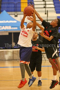 George P. Smith/The Montgomery Sentinel    G-Town's Anthony Wells (#10) taking it to the hoop.