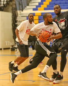 George P. Smith/The Montgomery Sentinel    MoCo Big III Select's Jeremy Williams (#4) driving the lane.