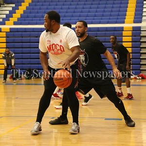 George P. Smith/The Montgomery Sentinel    MoCo Big III Select's Gus Chase (#10) posting up against Victors' Mike Brevner (#7).