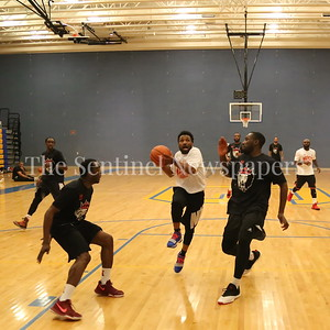 George P. Smith/The Montgomery Sentinel    MoCo Big III Select's Brandan Sims (#1) taking it to the hoop between two Victors' players.