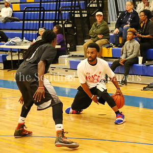 George P. Smith/The Montgomery Sentinel    MoCo Big III Select's Brandan Sims (#1) working against Victors' Dele Ojo (#3).