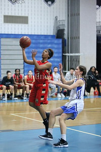 "George P. Smith/The Montgomery Sentinel    Wheaton High School's Ahmyria Simmons (#3) takes it to the hoop past James Hubert ""Eubie"" Blake High School's Brooke Boyd (#4)"