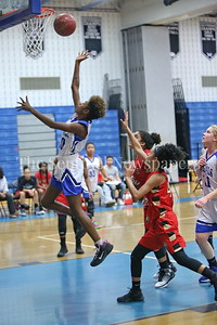 "George P. Smith/The Montgomery Sentinel    James Hubert ""Eubie"" Blake High School's Cimiya Duffin (#10) with the layup."