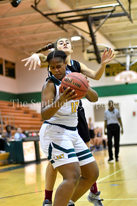 Kennedy's Aria Lewis guards the ball against a swipe from Whitman's Mathilda Mackay. Whitman vs Kennedy Girls Varsity Basketball Photo Credit:  David Wolfe