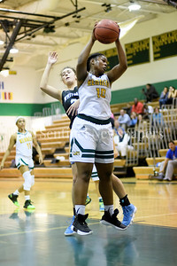 Kennedy's Aria Lewis pulls in a rebound. Whitman vs Kennedy Girls Varsity Basketball Photo Credit:  David Wolfe