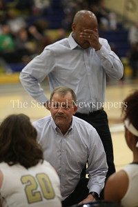 George P. Smith/The Montgomery Sentinel    Our Lady of Good Cousel Catholic High School's Assistant Coach Milt Kimbrough holds his head in anguish as Head Coach Tom Splaine tries to rally his players during a time out with Lady Falcons trailing badly to Saint Paul VI Catholic High School.