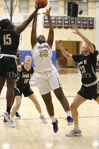 George P. Smith/The Montgomery Sentinel    Saint Paul VI Catholic High School's Ashley Owusu (#15) outrebounds Our Lady of Good Cousel Catholic High School's Lauren Amoo (#30).