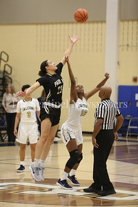George P. Smith/The Montgomery Sentinel   Saint Paul VI Catholic High School's Tennessee commit Amira Collins (#23) leaves Our Lady of Good Cousel Catholic High School's Rayne Tucker (#12) flatfooted at the tip off.