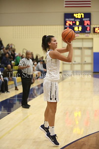 """George P. Smith/The Montgomery Sentinel    Our Lady of Good Cousel Catholic High School's Margaret """"Meggie"""" Burgess (#23) shoots from beyond the arc with Good Counsel trailing 39-24 in the 3rd quarter."""