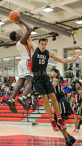 Kiksi's Jaka Pandza gets another block - this time against Kamari Williams of St. Andrews. PHOTO BY MIKE CLARK