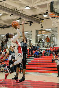 St. Andrew's Heru Bligen drives the lane for 2 first half points. PHOTO BY MIKE CLARK.