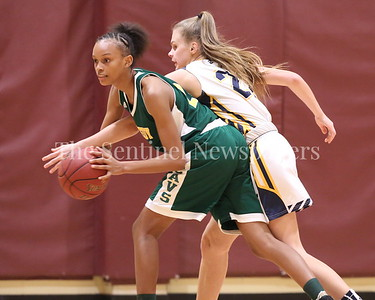 George P. Smith/The Montgomery Sentinel    Bethesda-Chevy Chase High School's Sophia James (#22) reaches in on John F. Kennedy High School's Kaylynn Bromell (#22) in the CKA SAVE Project 2017 Holiday Tournament Final played at Howard Community College Wednesday December 27, 2017.