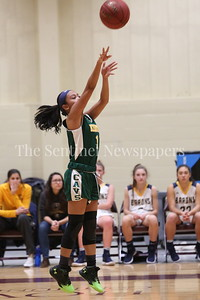 George P. Smith/The Montgomery Sentinel    John F. Kennedy High School's Jamie Quinto (#11) shoots from the perimeter against Bethesda-Chevy Chase High School in the CKA SAVE Project 2017 Holiday Tournament Final played at Howard Community College Wednesday December 27, 2017.