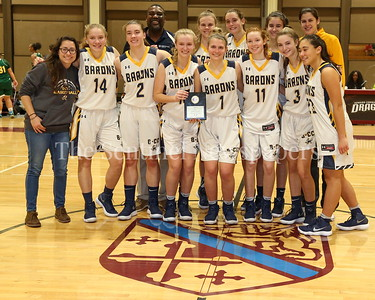 George P. Smith/The Montgomery Sentinel    The Bethesda-Chevy Chase High School Lady Barons won the CKA SAVE Project 2017 Holiday Tournament Final played at Howard Community College Wednesday December 27, 2017. BBC fist played in the tournament in 2011 has made a total of 5 appearances. Pictured in the back is Keith Adams, founder and President of the CKA SAVE Project and BCC head Coach Ryan Ingalls (in yellow - right end back row).