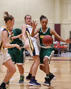 George P. Smith/The Montgomery Sentinel    Bethesda-Chevy Chase High School's Caitlyn Clendenin (#21) watches as John F. Kennedy High School's Kaylynn Bromell (#22) goes after a loose ball in the CKA SAVE Project 2017 Holiday Tournament Final played at Howard Community College Wednesday December 27, 2017.