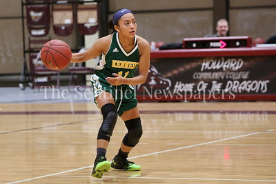 George P. Smith/The Montgomery Sentinel    John F. Kennedy High School's Jamie Quinto (#11) looks to feed the ball against Bethesda-Chevy Chase High School in the CKA SAVE Project 2017 Holiday Tournament Final played at Howard Community College Wednesday December 27, 2017.