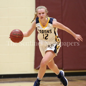 George P. Smith/The Montgomery Sentinel    Bethesda-Chevy Chase High School's Merete Cowles (#12) brings the ball up court for the Lady Barons in the CKA SAVE Project 2017 Holiday Tournament Final played at Howard Community College Wednesday December 27, 2017.