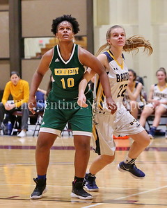 George P. Smith/The Montgomery Sentinel    Bethesda-Chevy Chase High School's Sophia James (#22) battles John F. Kennedy High School's Asia Lewis (#10) in the CKA SAVE Project 2017 Holiday Tournament Final played at Howard Community College Wednesday December 27, 2017.