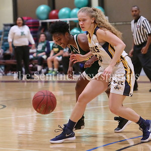 George P. Smith/The Montgomery Sentinel    Bethesda-Chevy Chase High School's Stephanie Howell (#14) battles John F. Kennedy High School's Asia Lewis (#10) in the CKA SAVE Project 2017 Holiday Tournament Final played at Howard Community College Wednesday December 27, 2017.