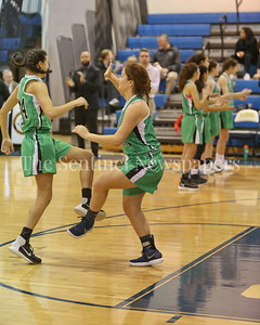 George P. Smith/The Montgomery Sentinel    Walter Johnson High School's Sonia Tavik (#14) and Katherine Papadopoulos (#21) dance a jig during introductions.