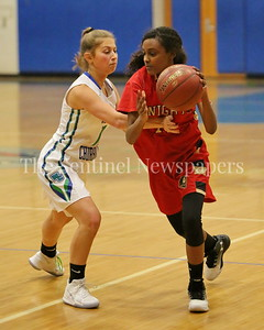 George P. Smith/The Montgomery Sentinel    Wheaton High School's Semhar Haile (#11) gets fouled by Winston Churchill High School's Abby Mazer (#12) during the game played at Churchill on Tuesday, January 2, 2018.
