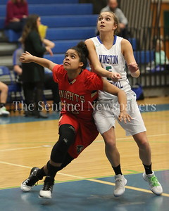 George P. Smith/The Montgomery Sentinel    Wheaton High School's Teefa Alli (#12) seriously leans into Winston Churchill High School's Kamryn Testa (#5) after a foul shot during the game played at Churchill on Tuesday, January 2, 2018.