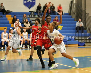 George P. Smith/The Montgomery Sentinel    Wheaton High School's Crystal Jones (#13) tries to cut off Winston Churchill High School's Brittini Martin (#4) as she drives the lane during the game played at Churchill on Tuesday, January 2, 2018.