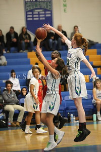 George P. Smith/The Montgomery Sentinel    Wheaton High School's Crystal Jones (#13) gets stuffed by Winston Churchill High School freshman Parker Hill (#33) as she takes it to the hoop during the game played at Churchill on Tuesday, January 2, 2018.