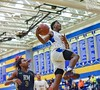 Running the court on a fast break Tao Huka goes for a dunk, and misses. <br /> Gaithersburg vs Richard Montgomery Boys Varsity Basketball<br /> Photo Credit:  David Wolfe